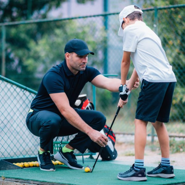 Golf,Lessons.,Golf,Instructor,Giving,Game,Lesson,To,A,Young